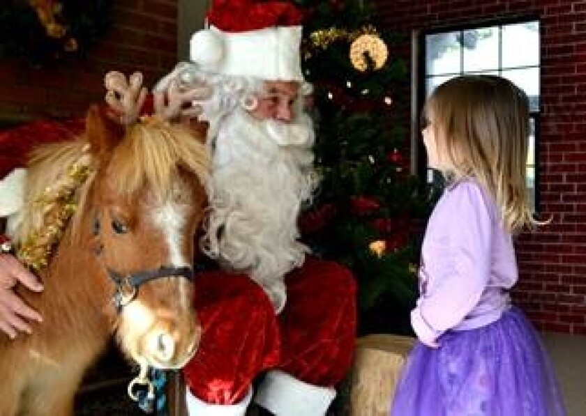 Helen Woodward Animal Center's Frosty Farm event offers children the opportunity to meet Santa, furry friends and more.