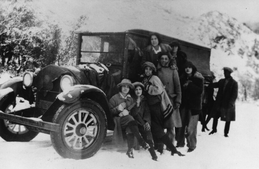 "Julia and Eloise Arciniega (far left) with friends on an outing to see the snow at Wrightwood or Big Pines, circa 1930. The photo is featured in Carolyn Kozo Cole's project, ""Shades of L.A."""