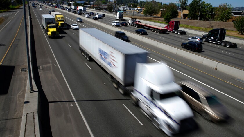 Trucks and cars on Interstate 5 near the Port of Tacoma in Washington.