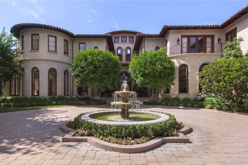 The 2.5-acre estate centers on a gated Mediterranean villa of more than 17,000 square feet.
