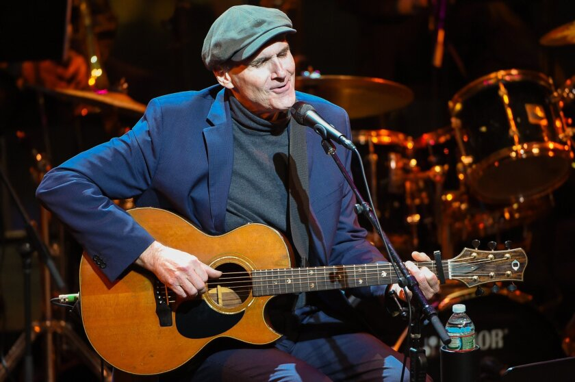 James Taylor, shown above, will hit the road with Jackson Browne next year. The two postponed their 2020 joint tour because of the novel coronavirus pandemic.