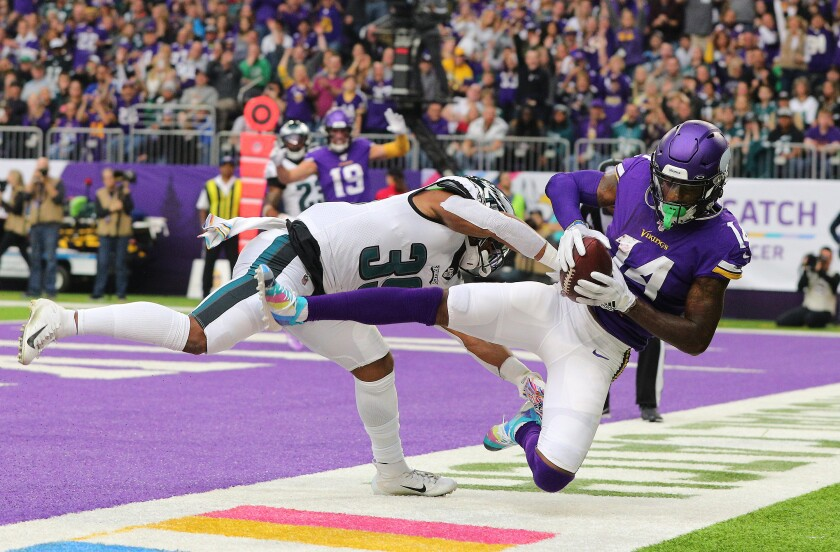 Minnesota Vikings wide receiver Stefon Diggs catches a touchdown pass in front of Philadelphia Eagles cornerback Craig James during the third quarter Sunday.