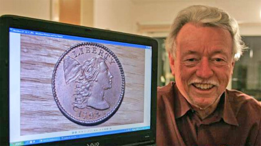 HOBBY PAYS OFF: Walter Husak displays a photo of a 1794 penny on a computer screen at his home in Van Nuys. The rare coin is among those he sold Friday for $10.7 million.