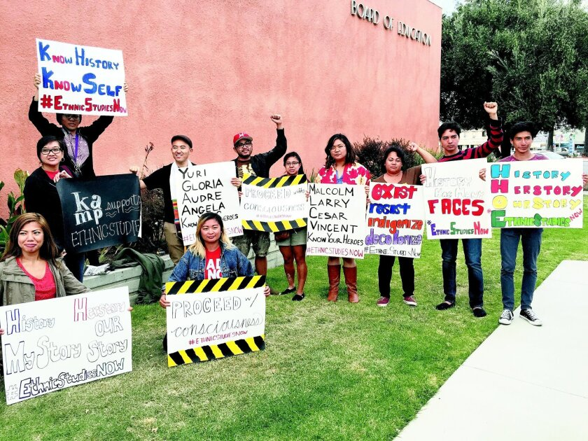 Members of a campaign to require ethnic studies courses in San Diego Unified School District stand outside the district office.