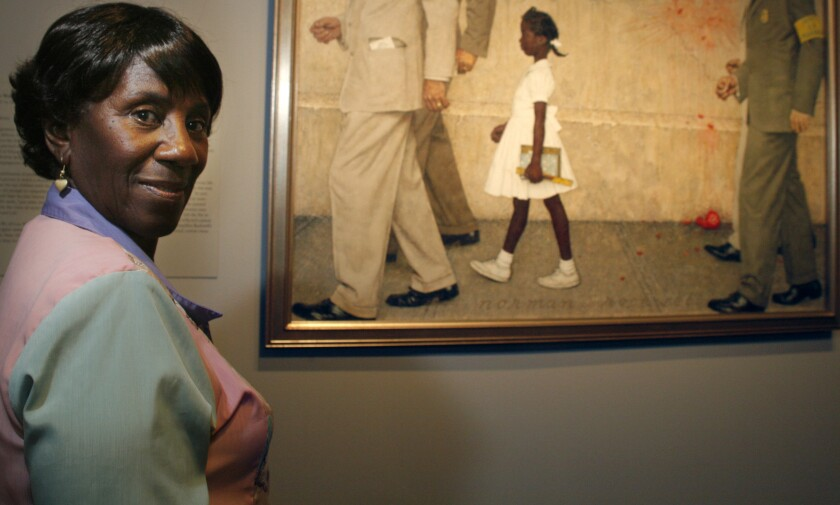 """Lucille Bridges poses next to the original 1964 Norman Rockwell painting, """"The Problem We All Live With"""""""