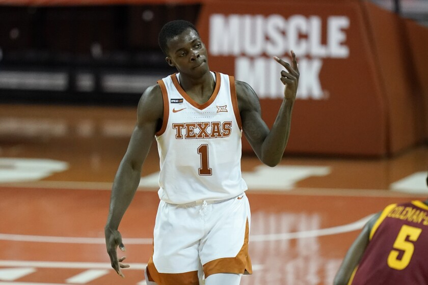 Texas guard Andrew Jones celebrates after making a 3-point basket during the second half of an NCAA college basketball game against Iowa State, Tuesday, Jan. 5, 2021, in Austin, Texas. (AP Photo/Eric Gay)