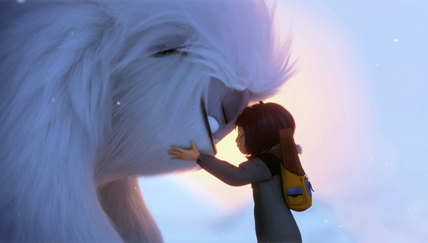 """This image released by DreamWorks Animation shows Everest the Yeti, left, and Yi, voiced by Chloe Bennet, in a scene from """"Abominable,"""" in theaters on Sept. 27. (DreamWorks Animation LLC. via AP)"""