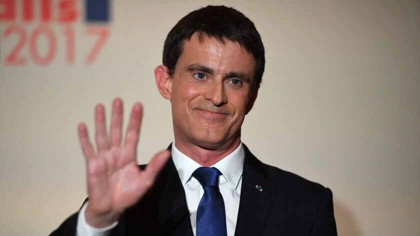 Defeated Socialist Party candidate Manuel Valls greets supporters after delivering a speech in Paris on Jan. 29, 2017.