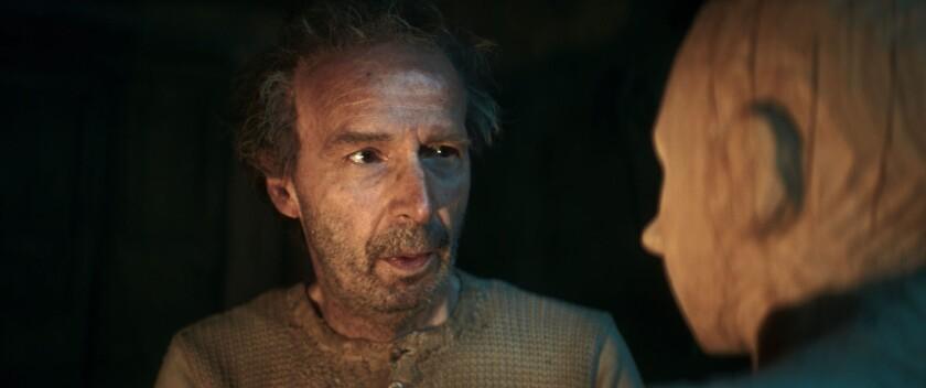 """Roberto Benigni as Geppetto in the movie """"Pinocchio."""""""