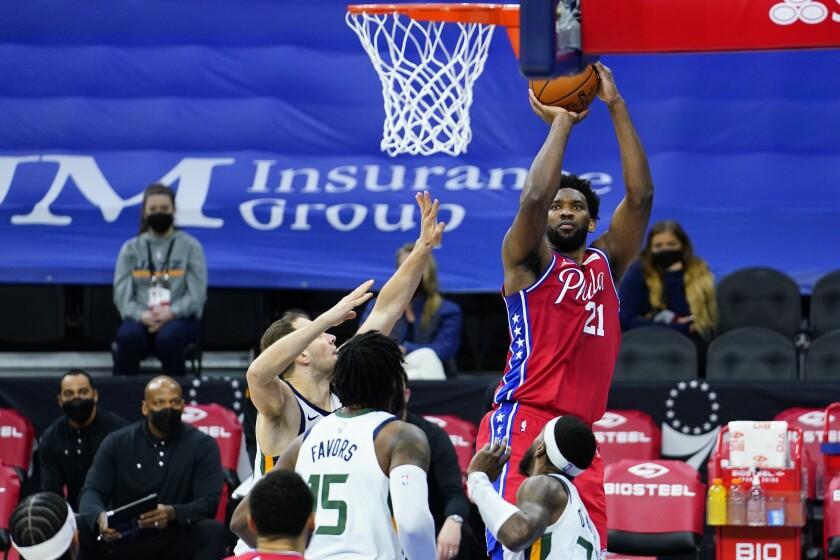 Philadelphia 76ers' Joel Embiid, right, goes up for a shot against Utah Jazz's Bojan Bogdanovic, left, during the first half of an NBA basketball game, Wednesday, March 3, 2021, in Philadelphia. (AP Photo/Matt Slocum)