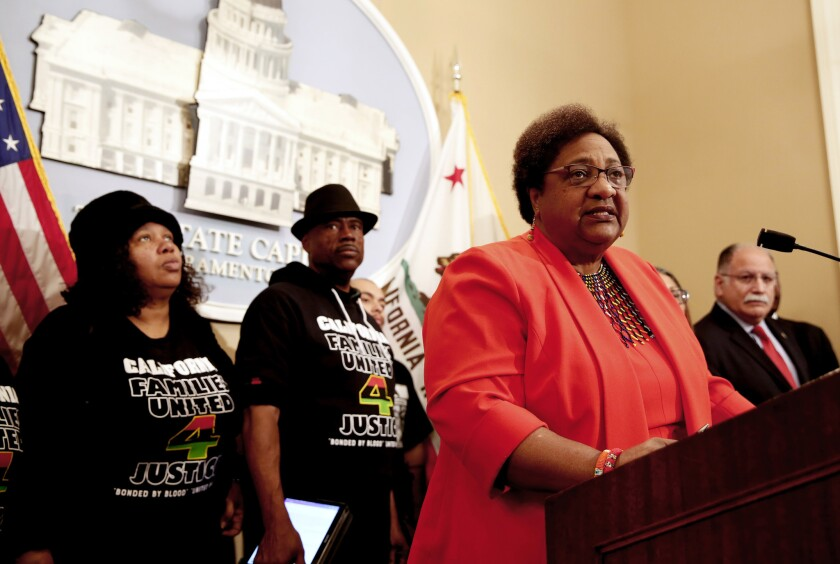 Assemblymember Shirley Weber, D-San Diego, discusses her bill that would allow police to use deadly force only when necessary and there is no reasonable alternative. At the February news conference in Sacramento, Weber was accompanied by Beatrice Johnson, left, and Cephus Johnson, center, the aunt and uncle of Oscar Grant, who was killed by BART police in Oakland in 2009.