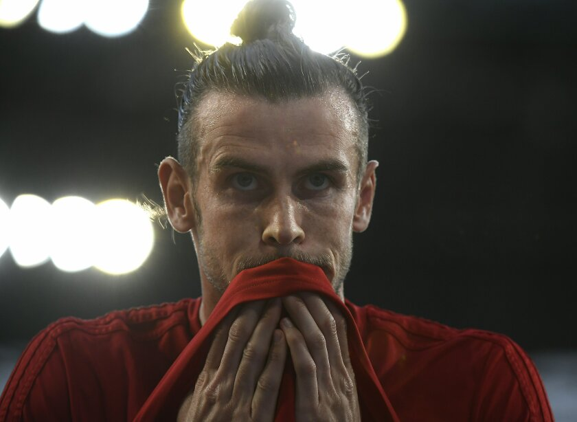 Gareth Bale of Wales warms up prior to the men's soccer 2020 European Championship Group E qualifying match between Hungary and Wales in Groupama Arena in Budapest, Hungary, Tuesday, June 11, 2019. (Tamas Kovacs/MTI via AP)