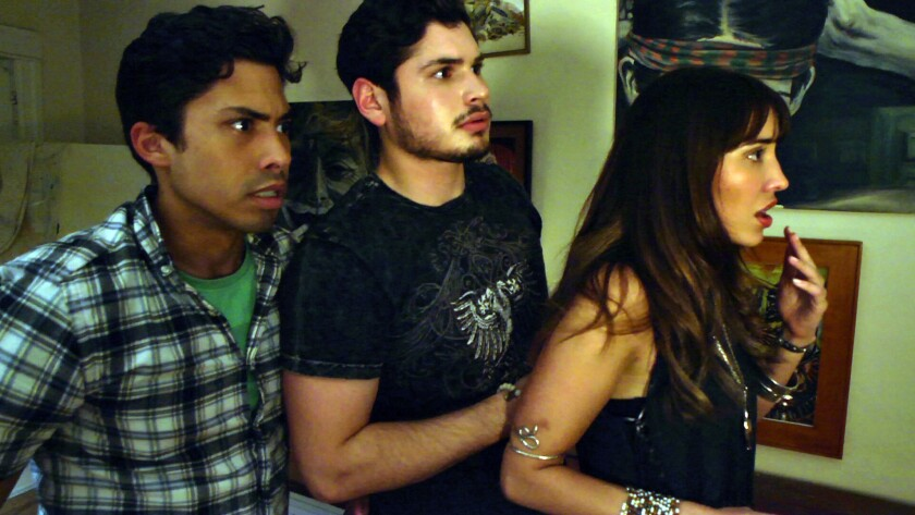 "J.R. Villarreal, Carlos Santos and Fernanda Romero in ""Ghost Team One."""