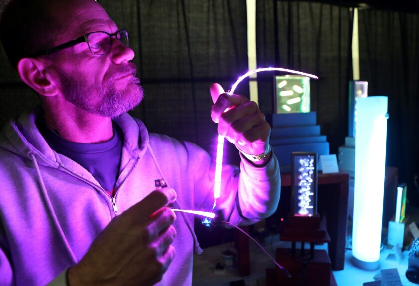 John Snyder shows off his LEDs with Arduino during the San Diego Mini Maker Faire that showcases technological inventions ranging from robotics and drones to countertop aquaponics and unicorn bikes.