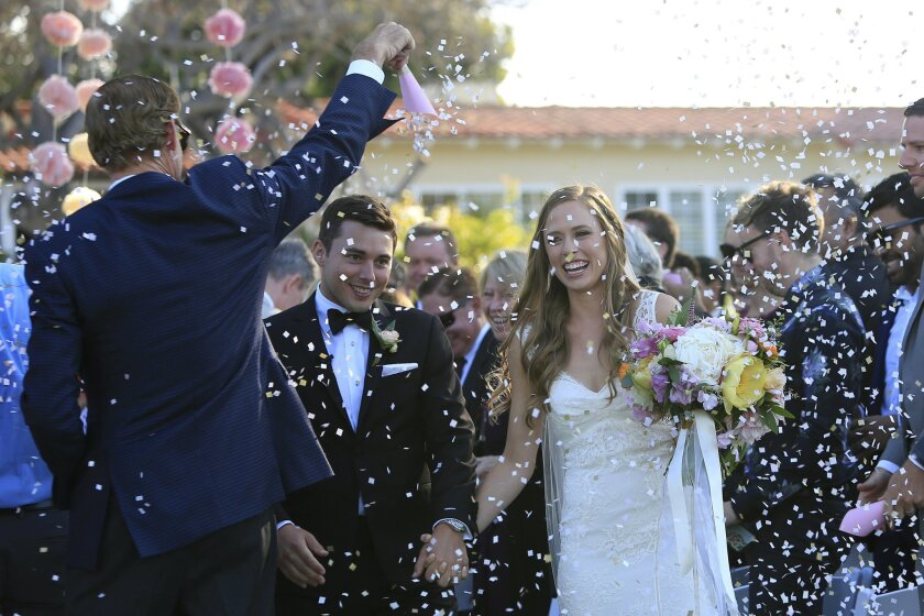 Newlyweds Nathan and Erica Moyer walk through a cloud of confetti as wedding singer Michael Tiernan played live music at The Inn at Rancho Santa Fe. The San Diego based singer, songwriter started a wedding singing business to supplement his music career. In a few years, his wedding business outpac