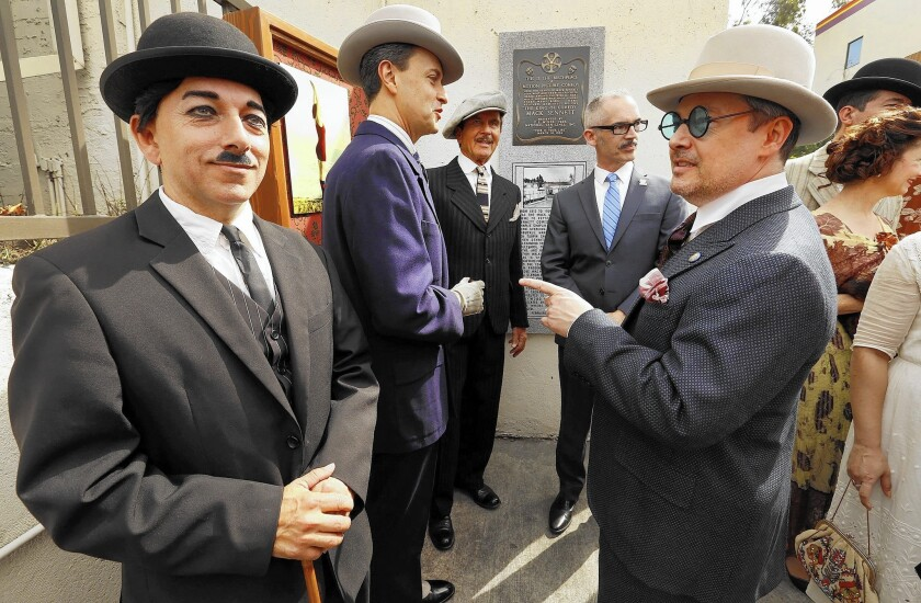 Pharaoh Kingsley, left, playing Charlie Chaplin, joins L.A. City Councilman Mitch O'Farrell, second from right, and others at the unveiling of a new plaque at the site of the old Mack Sennett film studio in what is now Echo Park.