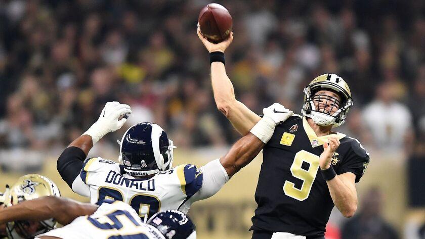 NEW ORLEANS, LOUISIANA, NOVEMBER 4, 2018-Rams Aaron Donald gets an arm on Saints quarterback Drew Br
