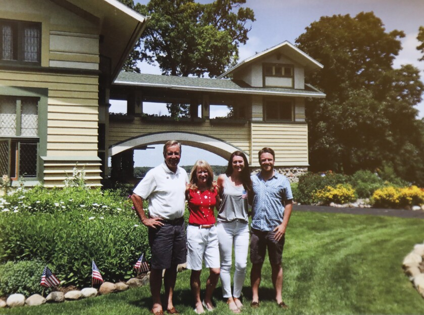 John and Sue Major, left, with their children Barbara, 27, and John B., 31, at Penwern, the 1902 Frank Lloyd Wright-designed home in Wisconsin that they have spent the past 25 years restoring to its original glory.