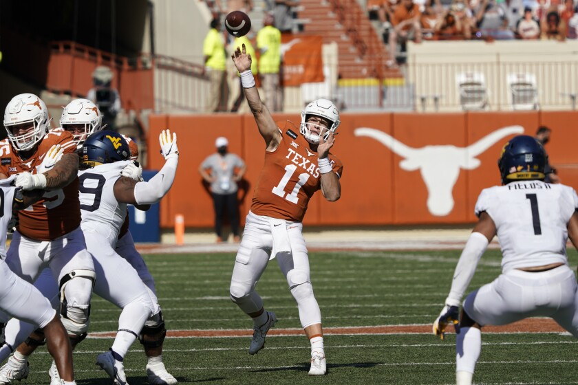 Texas' Sam Ehlinger (11) throws a pass against West Virginia during the second half of an NCAA college football game in Austin, Texas, Saturday, Nov. 7, 2020. (AP Photo/Chuck Burton)