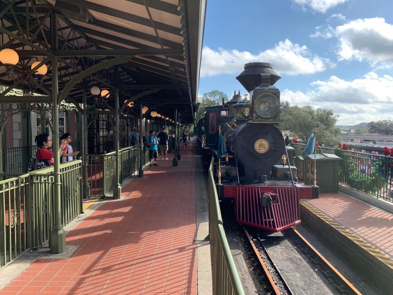 Magic Kingdom visitors take photographs of the engine for the temporarily dormant Walt Disney World Railroad.