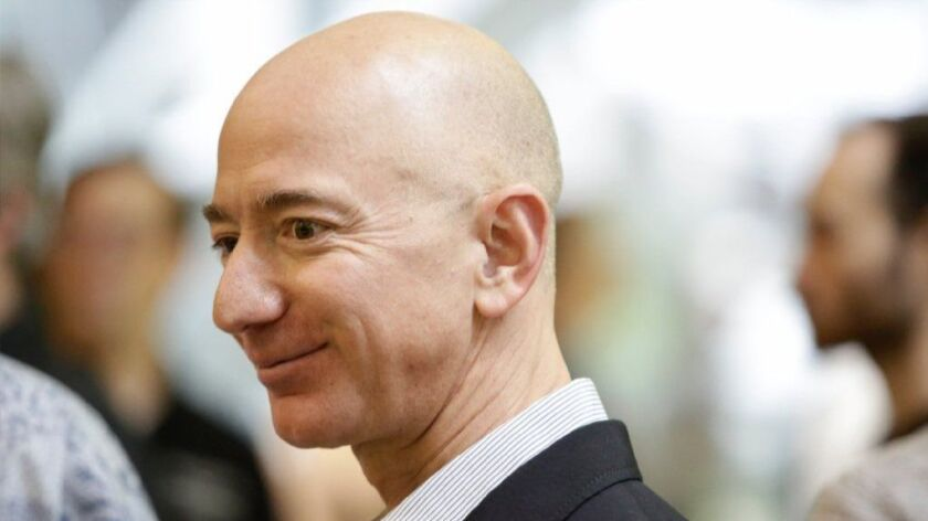 Amazon CEO Jeff Bezos tours the facility at the grand opening of the Amazon Spheres on Jan. 29 in Seattle.