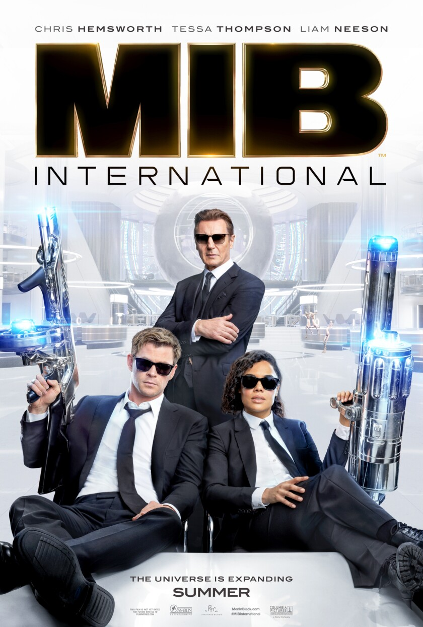 CAPTION 1 - NO CAPTION NECESSARY - MOVIE POSTER WITH 3 AGENTS.jpg