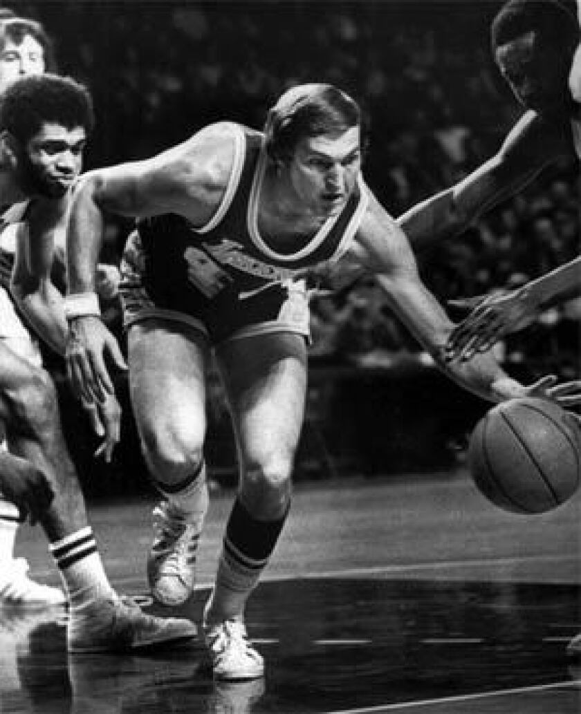 Lakers' Jerry West cuts through the pack to take charge of a loose ball during a game against the Milwaukee Bucks on  Jan. 21, 1974.