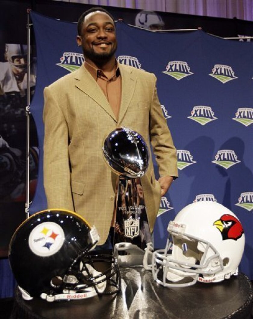 Pittsburgh Steelers head coach Mike Tomlin poses with the Vince Lombardi trophy during a news conference for NFL football Super Bowl XLIII Friday, Jan. 30, 2009, in Tampa, Fla. The Pittsburgh Steelers will play the Arizona Cardinals in Super Bowl XLIII on Sunday, Feb. 1. (AP Photo/David J. Phillip)