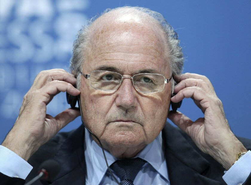 FILE - The June 1, 2011 file photo shows Swiss FIFA President Joseph (Sepp) Blatter during a press conference after the 61st FIFA Congress in Zurich, Switzerland. Blatter is seeking reelection at the FIFA congress in Zurich. Blatter is not among the six soccer officials who were arrested and detained by Swiss police on Wednesday, May 27, 2015 pending extradition at the request of U.S. authorities after a raid at a luxury hotel. The officials are in Switzerland for the FIFA congress and presidential election. (AP Photo/Michael Probst)