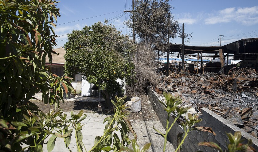 Homes along 52nd Street are directly behind the destroyed metal recycling facility.