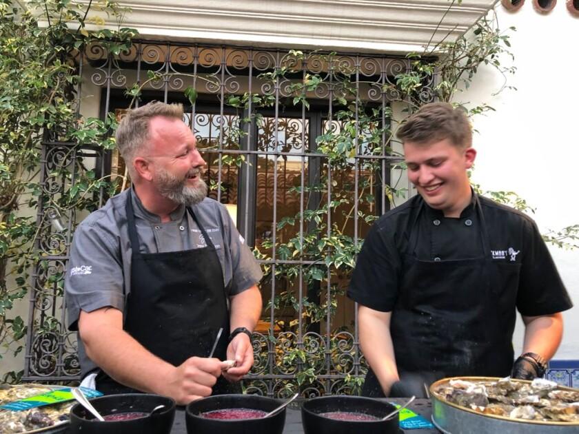 Valle de Guadalupe restaurateur Drew Deckman, left, shucks oysters with his son, Sam Deckman.