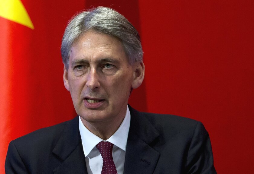 "FILE- In this Aug. 12, 2015, file photo, British Foreign Secretary Philip Hammond delivers his speech at Peking University in Beijing. Hammond confirmed the release of a British hostage, Douglas Robert Semple, by UAE forces in a military intelligence operation on Sunday, Aug. 23. ""The British national is safe and well, and is receiving support from British government officials,"" said Hammond. (AP Photo/Andy Wong, File)"