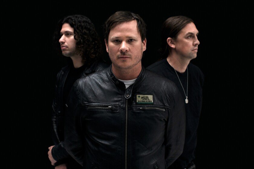 The members of Angels & Airwaves are, from left, Ilan Rubin, Tom DeLonge and David Kennedy.