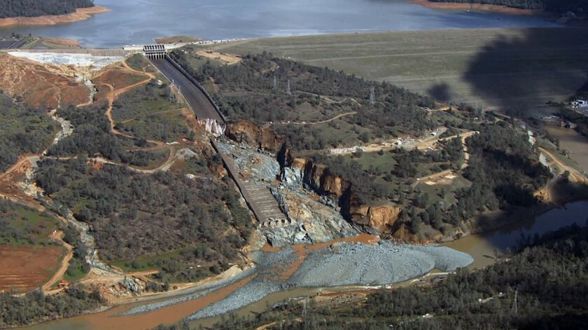 Oroville Dam's crippled spillway in a February file photo. With stormy weather approaching, California plans to resume releasing water down the damaged spillway at the nation's tallest dam.