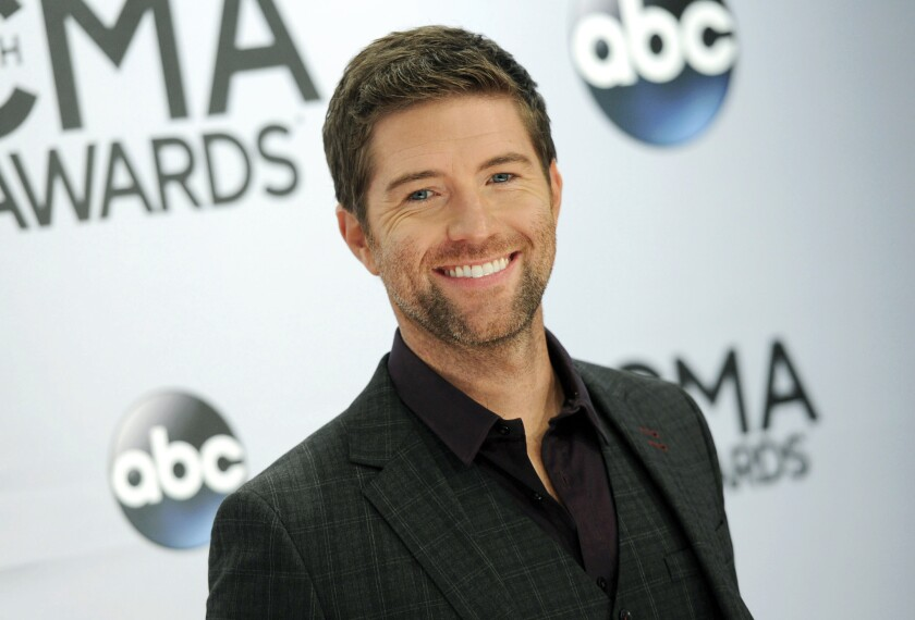 Josh Turner arrives at the CMA Awards in 2014. Authorities in central California say a bus crashed while carrying the road crew for the country and gospel singer.  Turner and his band were not on the bus.
