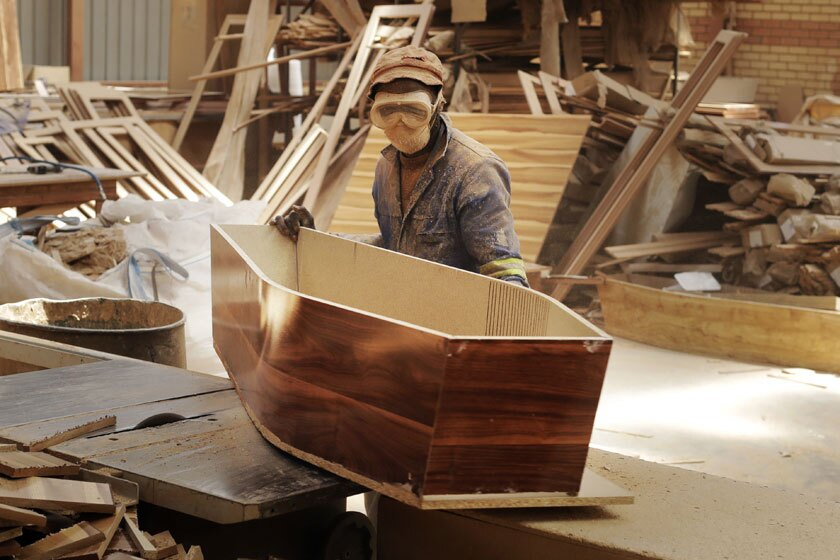 A worker constructs coffins at a Johannesburg shop.