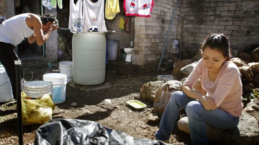 A woman deported from the U.S. living in Tepic, Mexico, stuck and without a job.