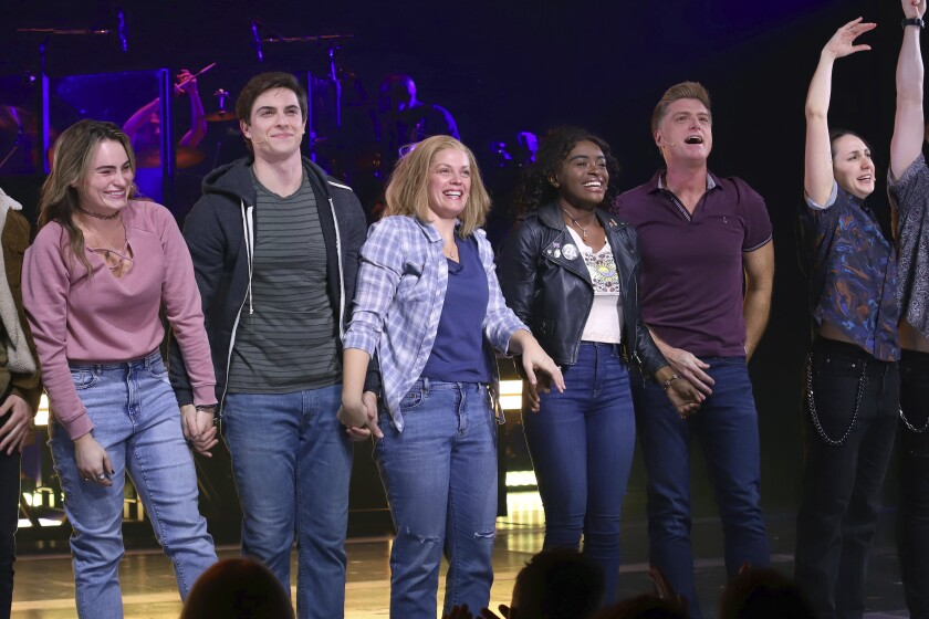 """FILE - Kathryn Gallagher, from left, Derek Klena, Elizabeth Stanley, Celia Rose Gooding, Sean Allan Krill and Lauren Patten appear on stage during the """"Jagged Little Pill"""" Broadway opening night curtain call at the Broadhurst Theatre on Dec. 5, 2019, in New York. Stanley has earned her first Tony Award nomination playing the mom of a Connecticut family spiraling out of control in the musical set to the music of Alanis Morissette's 1995 album of the same name. (Photo by Greg Allen/Invision/AP, File)"""