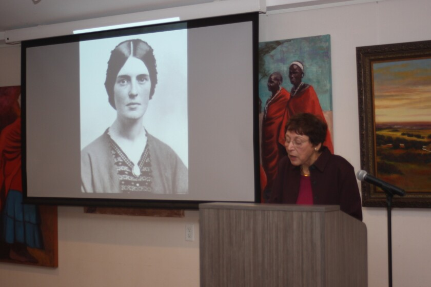 Harris shares images of the women in her book as she presents their achievements.