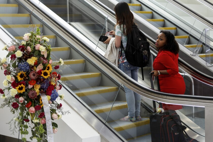 Flowers mark the terminal area where Gerardo Hernandez, a TSA employee, was killed during last November's shooting at Los Angeles International Airport. An airport security bill named in his honor is now proceeding through Congress.