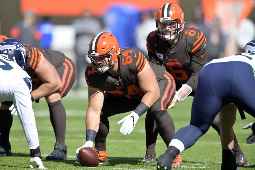 FILE - In this Oct. 13, 2019, file photo, Cleveland Browns center JC Tretter (64) lines up during an NFL football game against the Seattle Seahawks, in Cleveland. A person familiar with the negotiations says Browns' Tretter has agreed to terms on a three-year, $32.5 million contract extension with the club. Tretter, who is in his third season with the team, will receive $23 million guaranteed, said the person who spoke on condition of anonymity because the deal has not been finalized. An announcement could come Friday, Nov. 8, 2019, the person said. (AP Photo/David Richard, File)