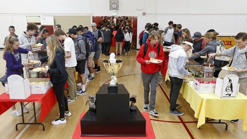 Student athletes enjoy a luncheon catered by Newport Rib Company for winning the All-Sports Cup Trop