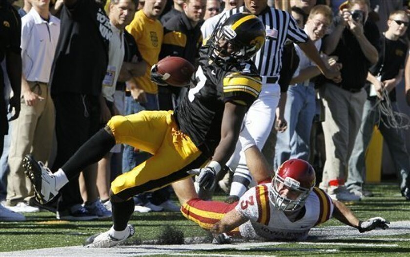 Iowa wide receiver Marvin McNutt is run out of bounds by Iowa State cornerback Zac Sandvig (3) after making a reception during the first half of an NCAA college football game, Saturday, Sept. 11, 2010, in Iowa City, Iowa. (AP Photo/Charlie Neibergall)