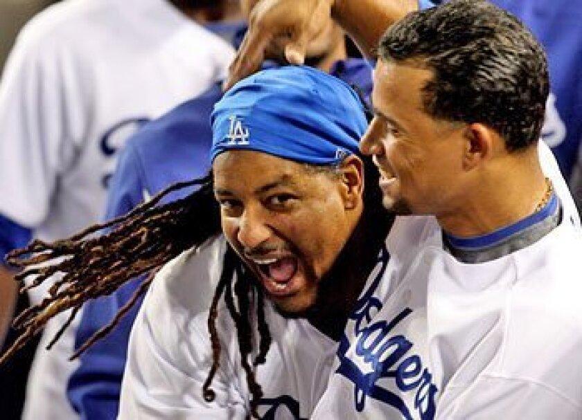 The Dodgers' Manny Ramirez (left) celebrates with Rafael Furcal after homering. (Keith Birmingham / Associated Press)