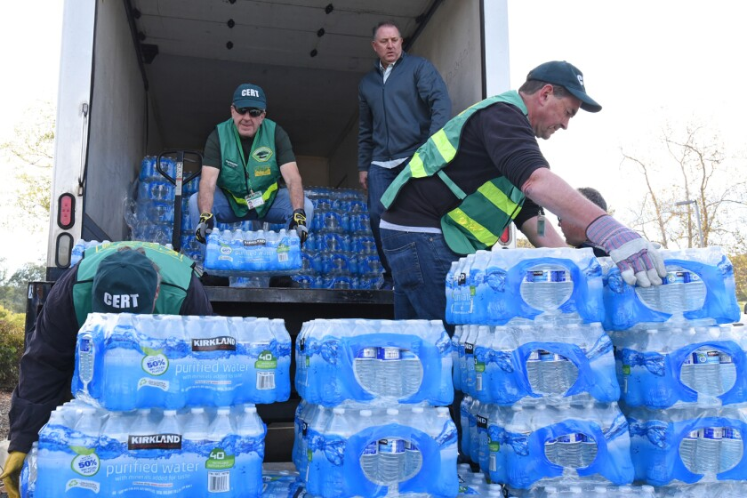 Hundreds of thousands of water bottles were given to Poway residents during the boil water advisory in late November/early December. Here Poway CERT members unload bottled water to be distributed at Lake Poway.