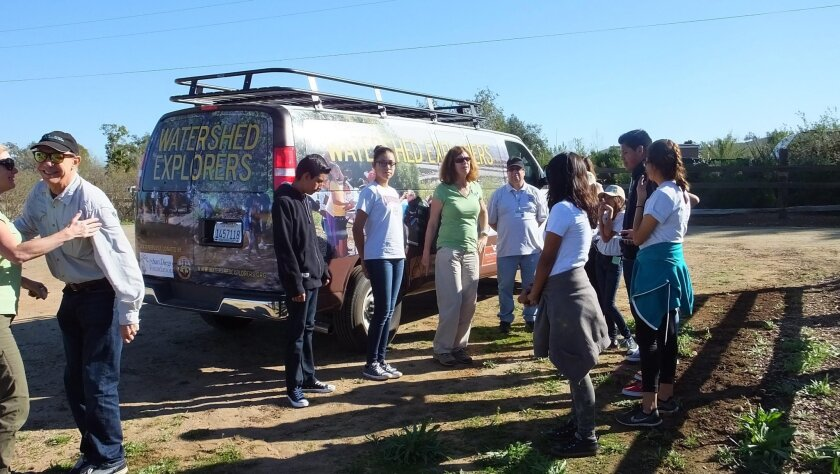 Students from Monroe Middle School, who are participating in the San Dieguito River Valley Conservancy's nature education program, get ready to climb aboard special Watershed Explorers Program van.