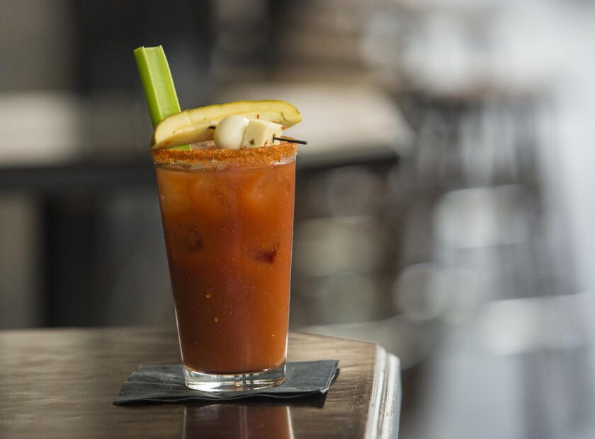 The noise on an airplane can make your Bloody Mary taste better, according to a new study by Cornell University. Pictured is a Cole's regular Bloody Mary in Los Angeles.