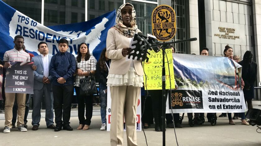 Hiwaida Elarabi of Massachusetts, speaking outside the federal building in San Francisco last month, is a Sudanese beneficiary of Temporary Protected Status and a plaintiff in the lawsuit over the termination of those protections.