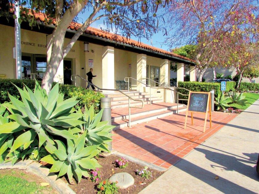 Botanicals courtesy of La Jolla Garden Club flank the entrance to La Jolla Library on Draper Ave. Susan DeMaggio