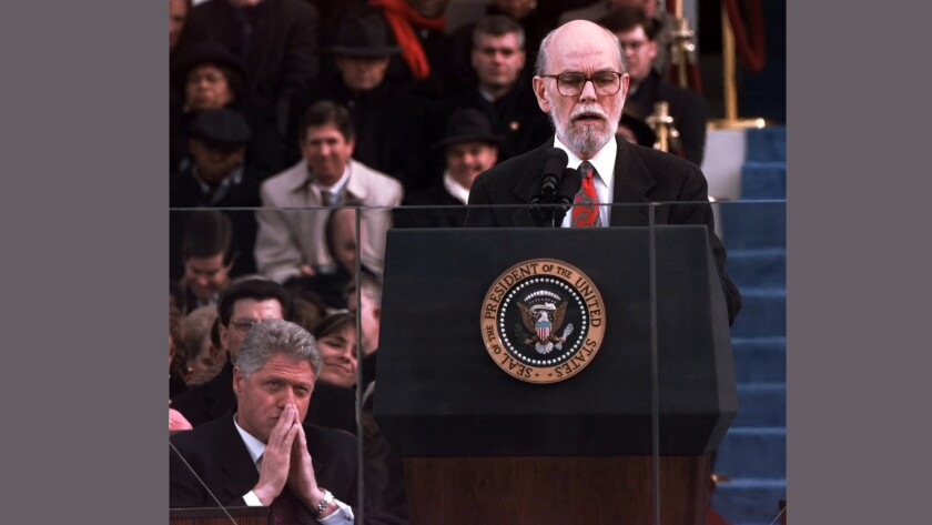 Miller Williams reading at the 1997 inaugural, with President Clinton listening in the background.